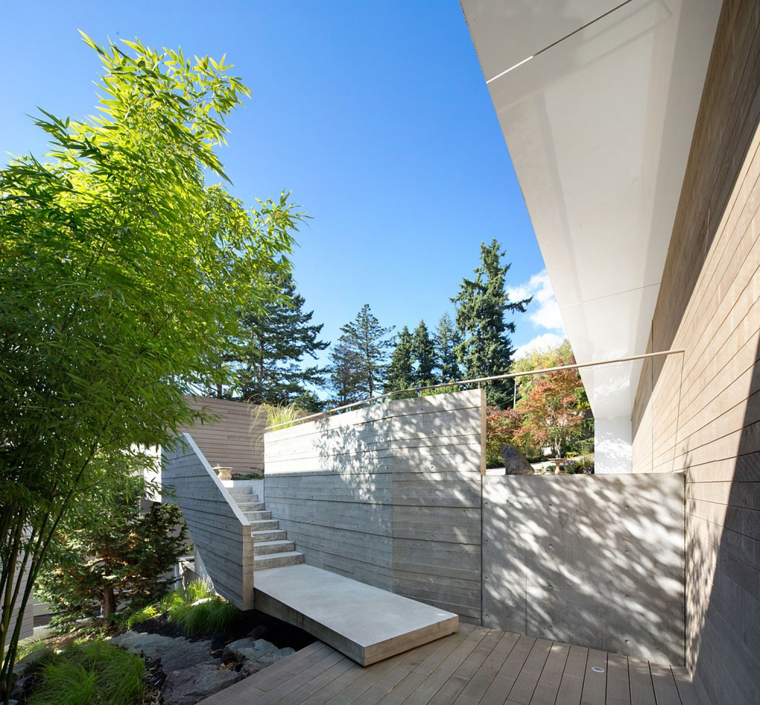 Split level arrangement and half-story stairways create a smart entry at the Vancouver home