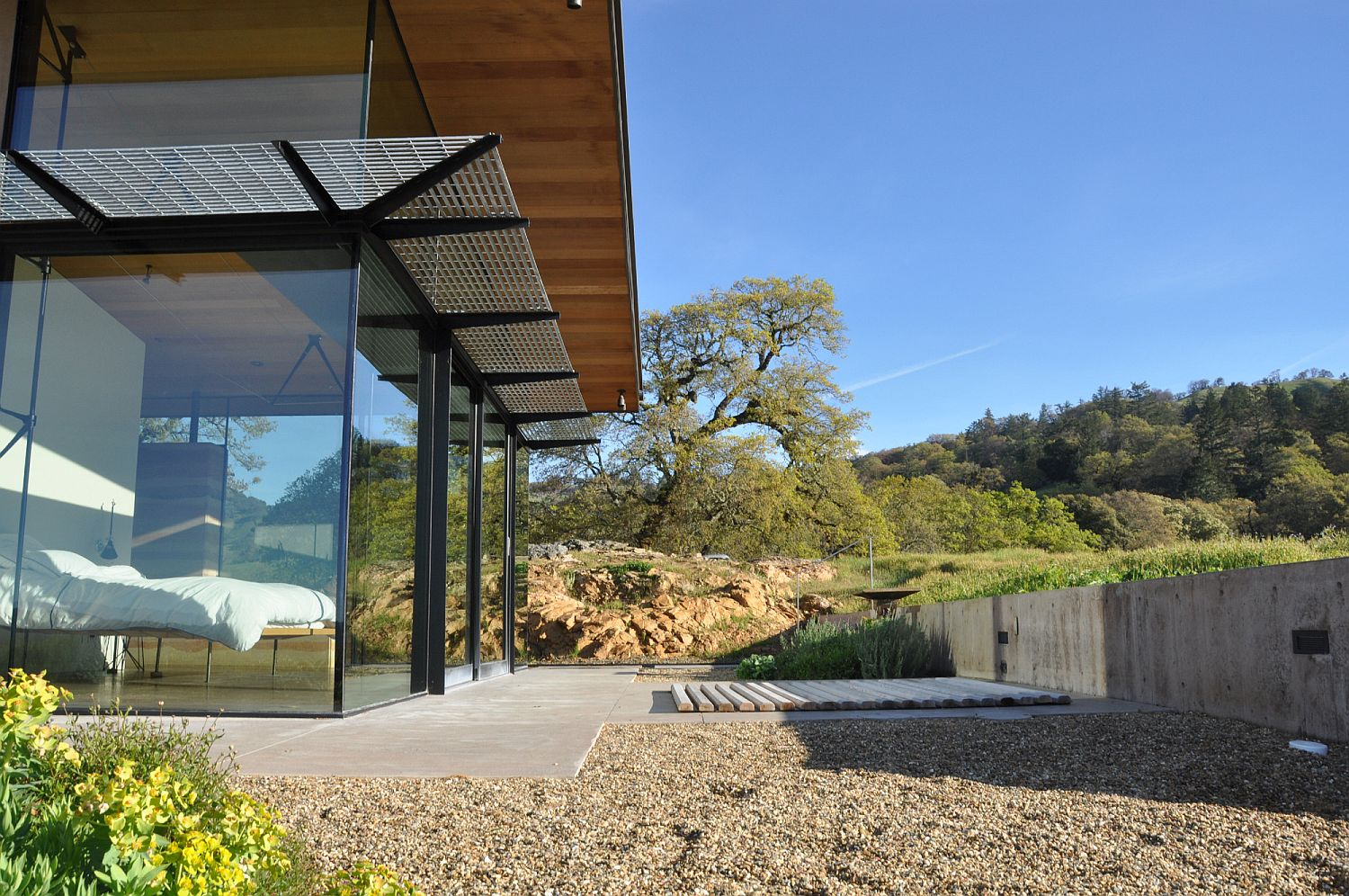 Steel and wood frame of the house accentuated by the extensive use of glass