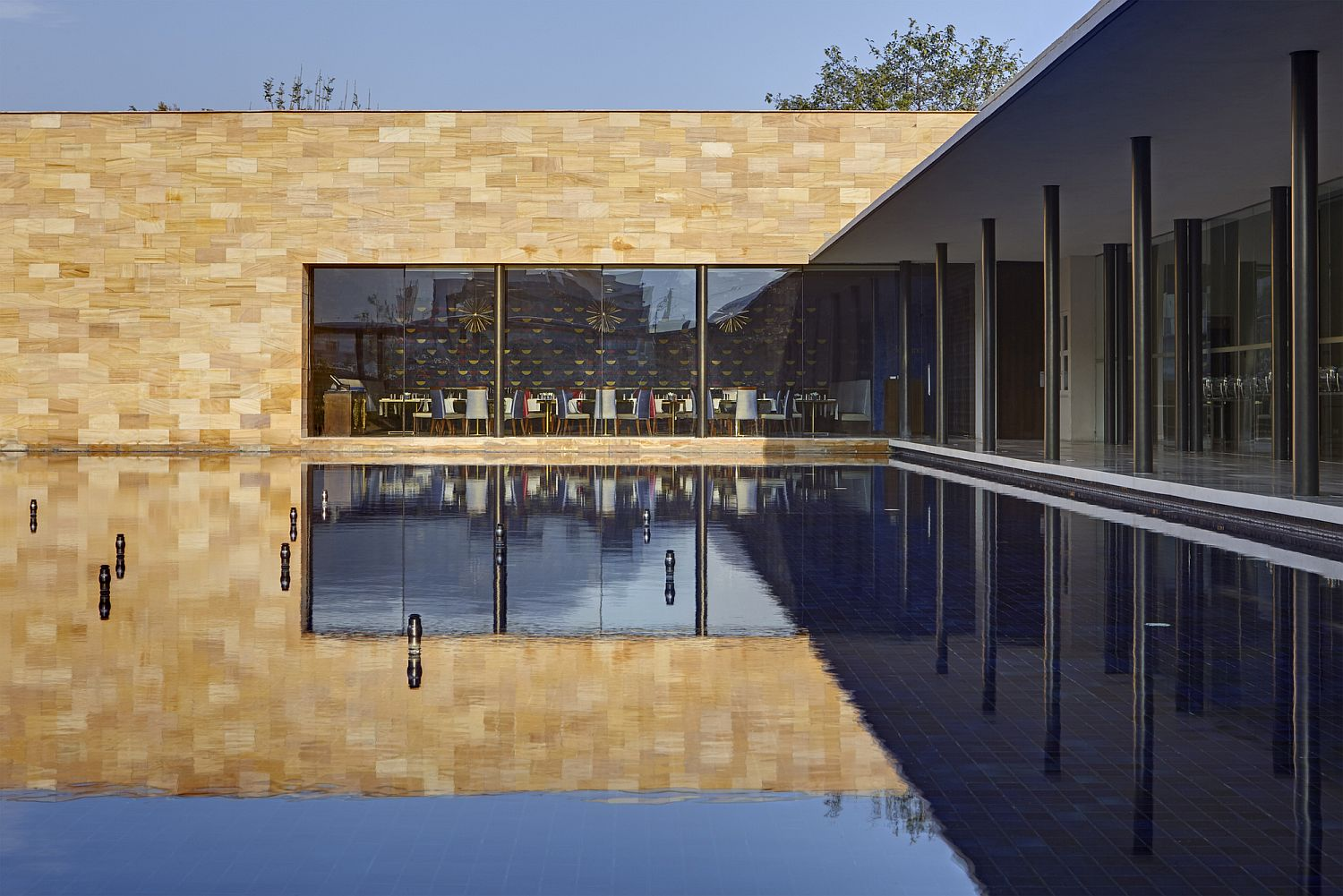Still pond at the heart of the hotel becomes much more than an aesthetic addition