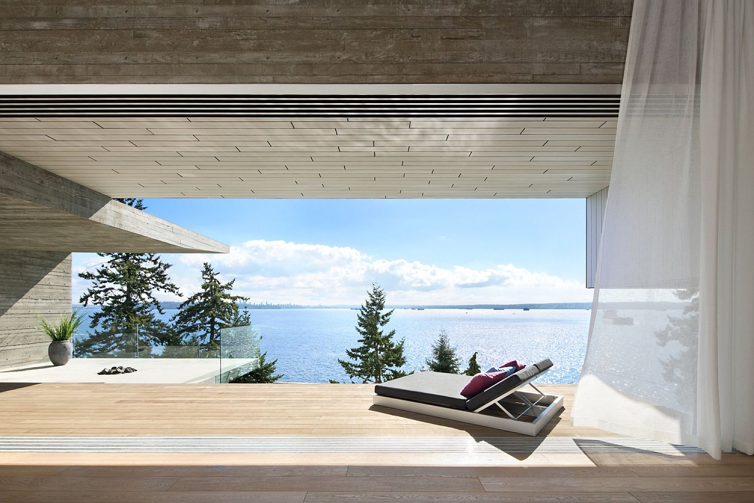 Stunning minimal home in Weste Vancouver with unabated ocean views and a lavish deck