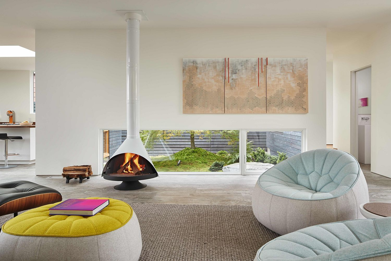Stylish contemporary fireplace in white matches with the color scheme of the contemporary living room