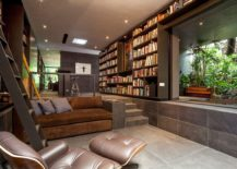 Sunken-living-room-idea-with-a-view-of-the-green-courtyard-outside-217x155