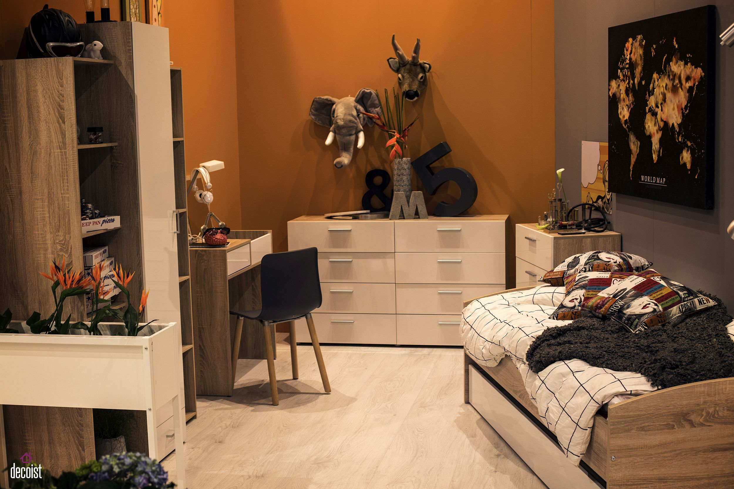 Teen bedroom in orange and black with ultra-small workdesk, ample cabinet space and a trundle bed with storage options