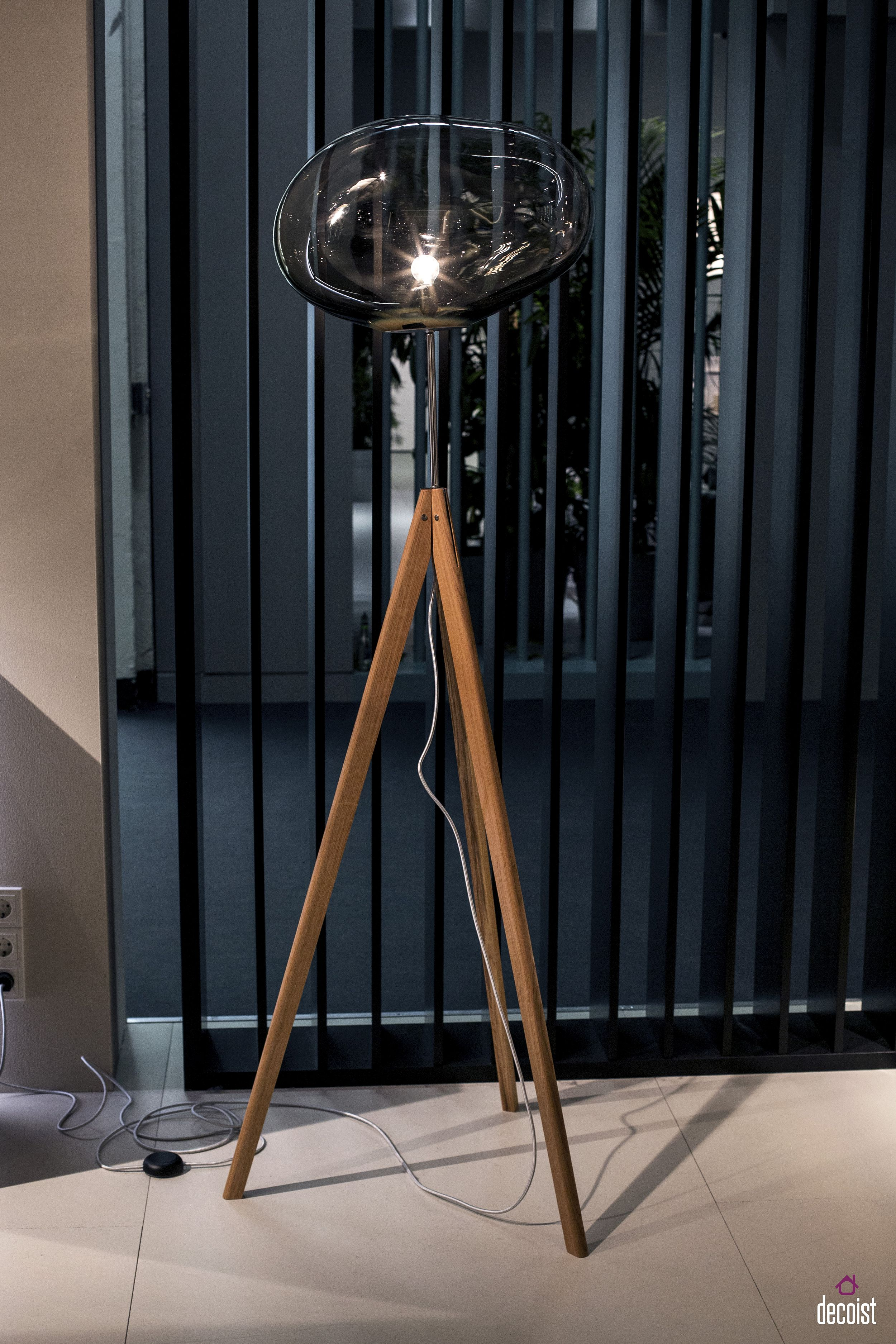 Tripod base and exquisite glass lamp make this floor light truly one of a kind