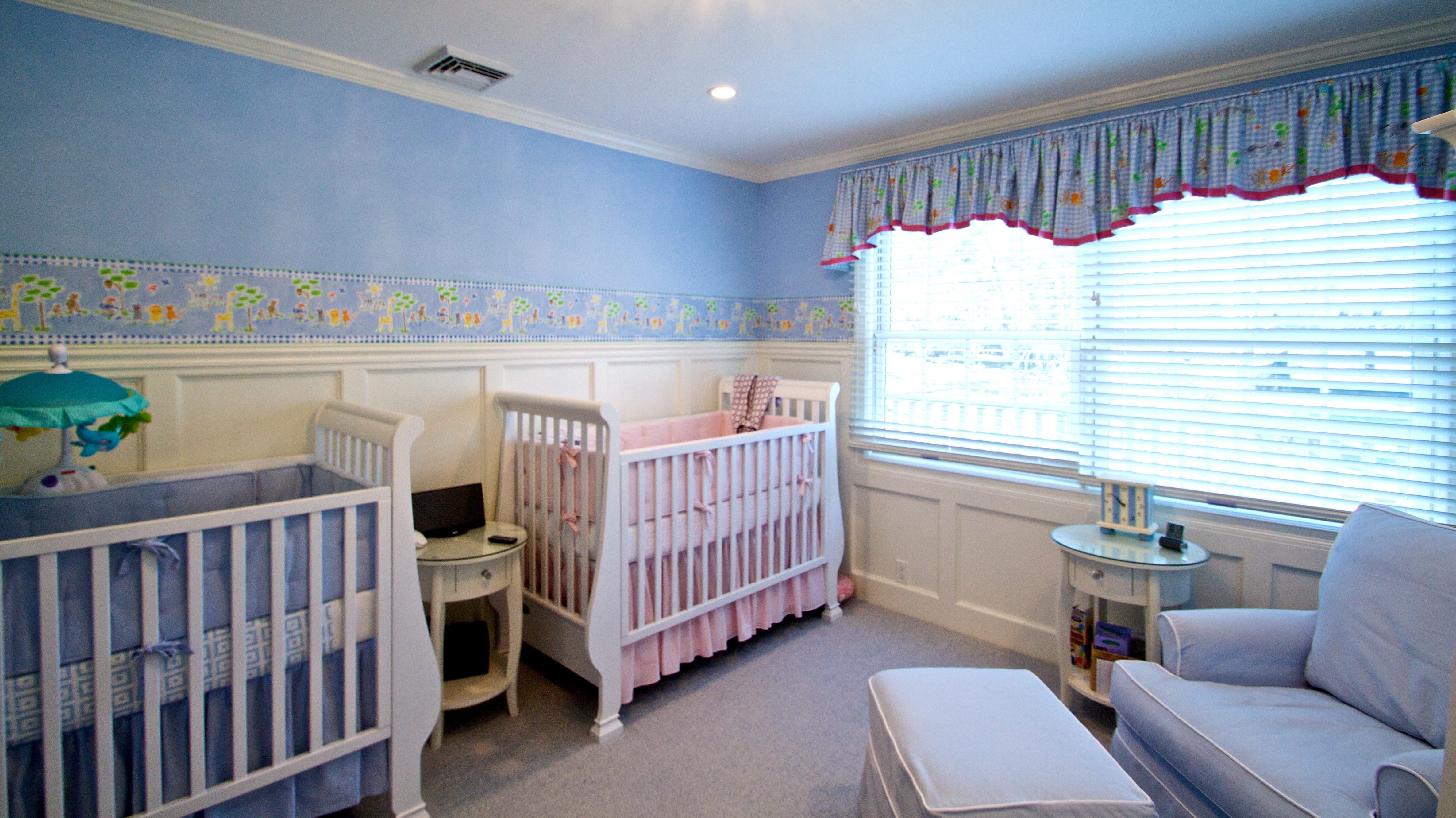 Twin nursery for a boy and a girl