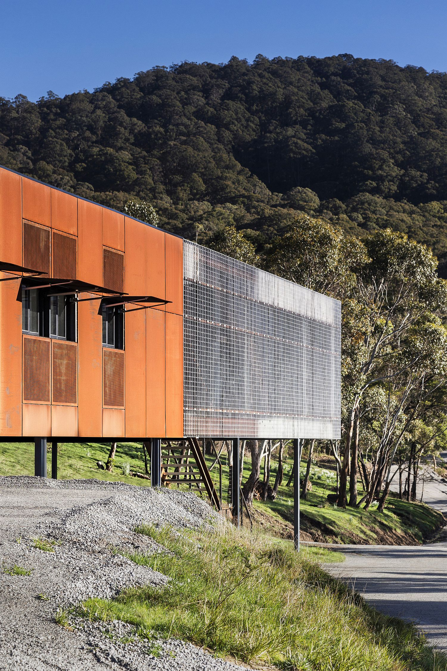 Unique and metallic exterior of the bushland home protects it from harsh weather and bushfires
