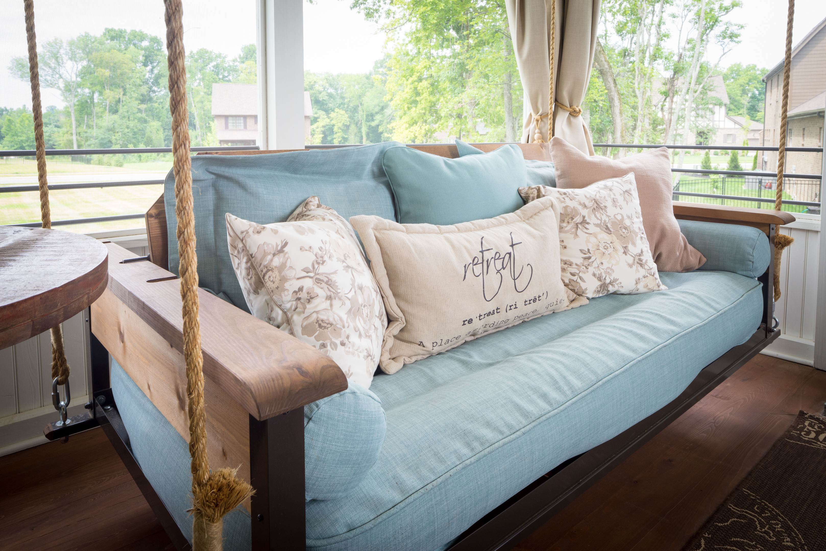 Unique porch swing with cushioning resembling denim