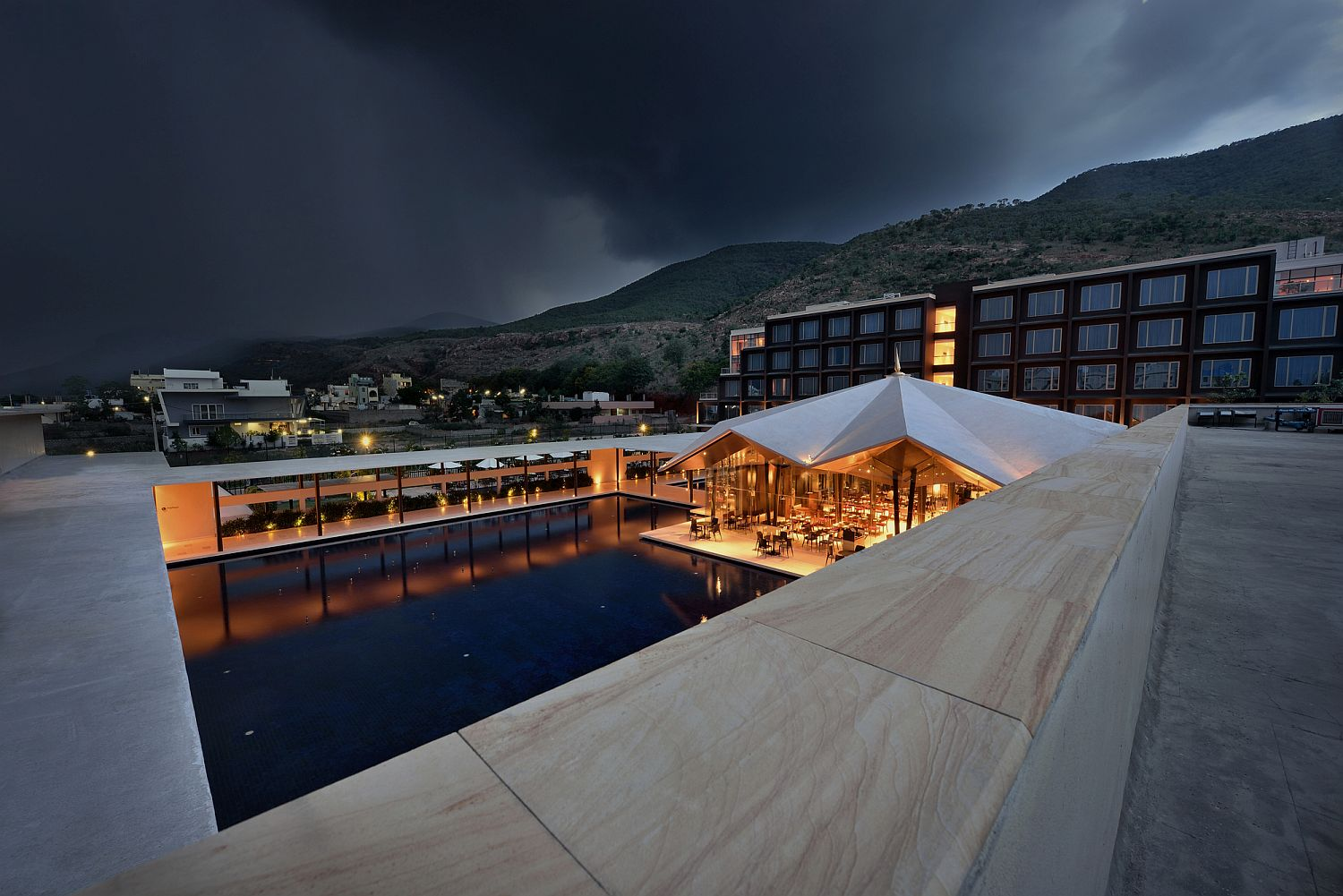 View from above of the majestic luxury hotel with the Spatagiri hills in the backdrop