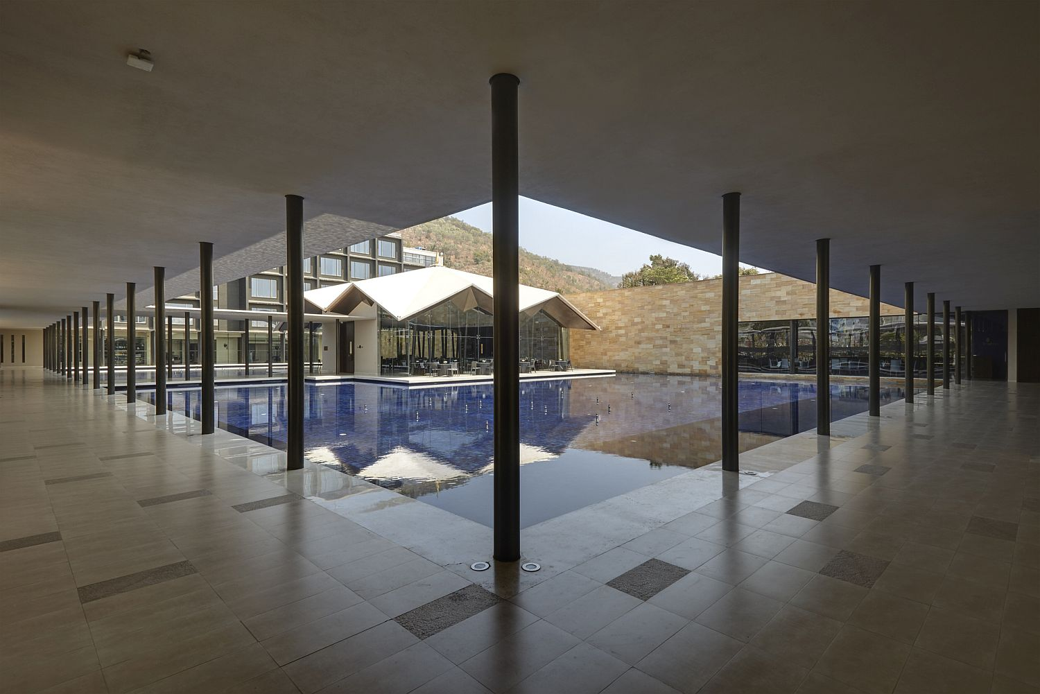 View of the central pool and courtyard at Hotel Dasavatara