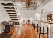 View-of-the-glass-floor-from-the-lower-level-of-the-Scandinavian-home-217x155
