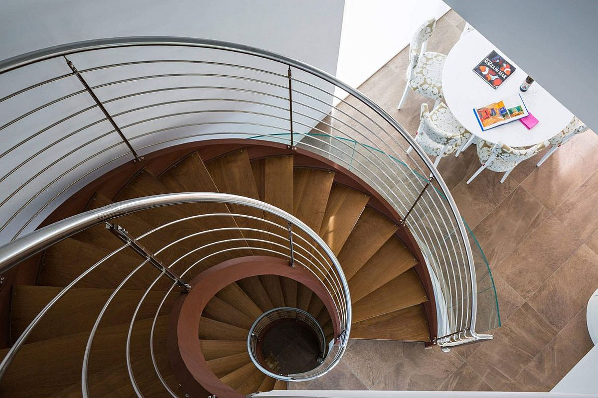 View of the spiral staircase from the top level of Casa Finestrat