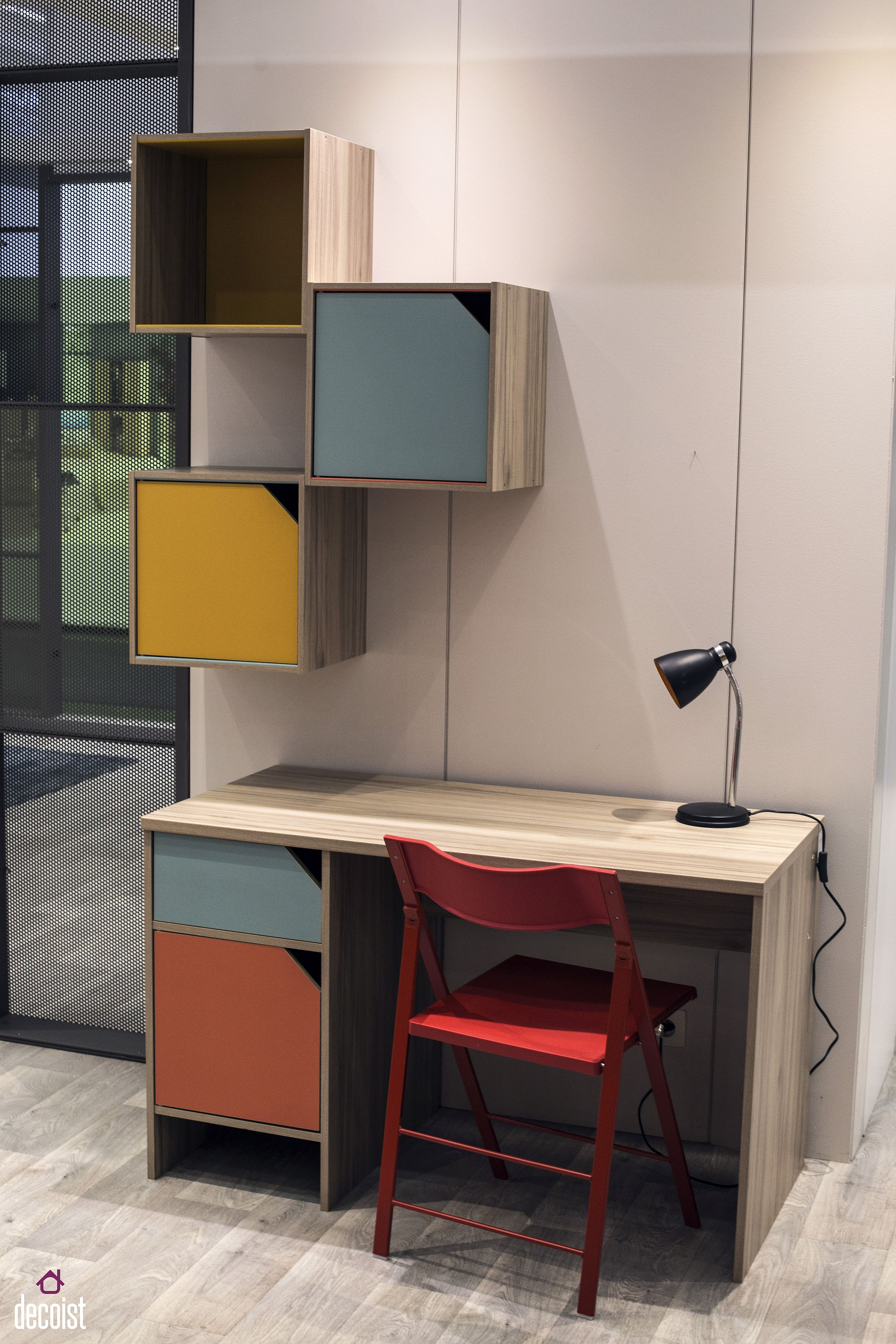 Wall-mounted modular units offer colorful storage options in the contemporary kids' room