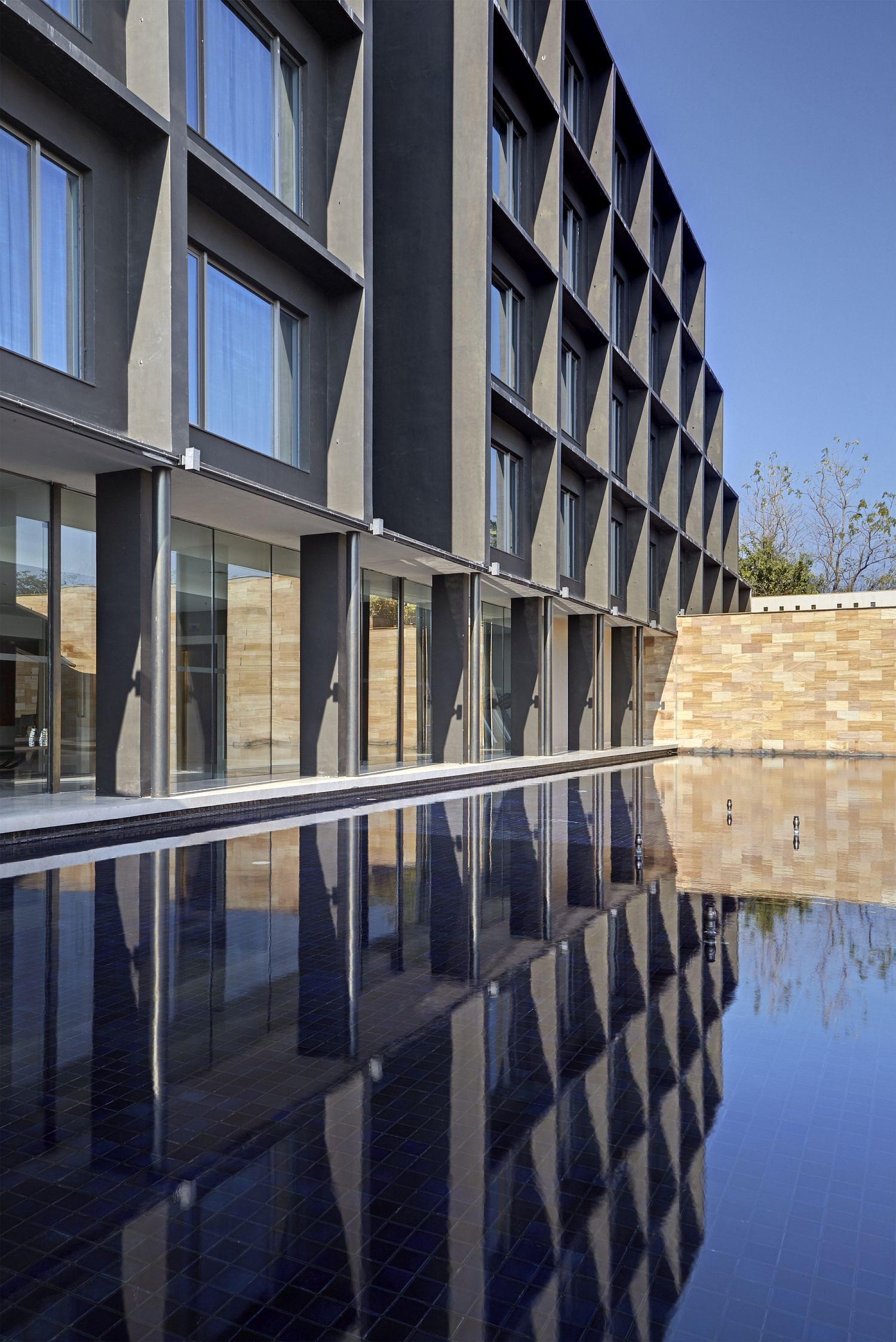 Water reflects the main structure of the hotel
