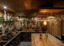 Wine-cellar-clad-in-wood-with-ample-storage-217x155