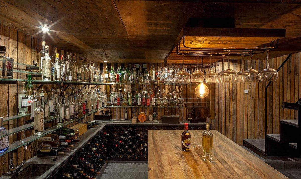 Wine cellar clad in wood with ample storage