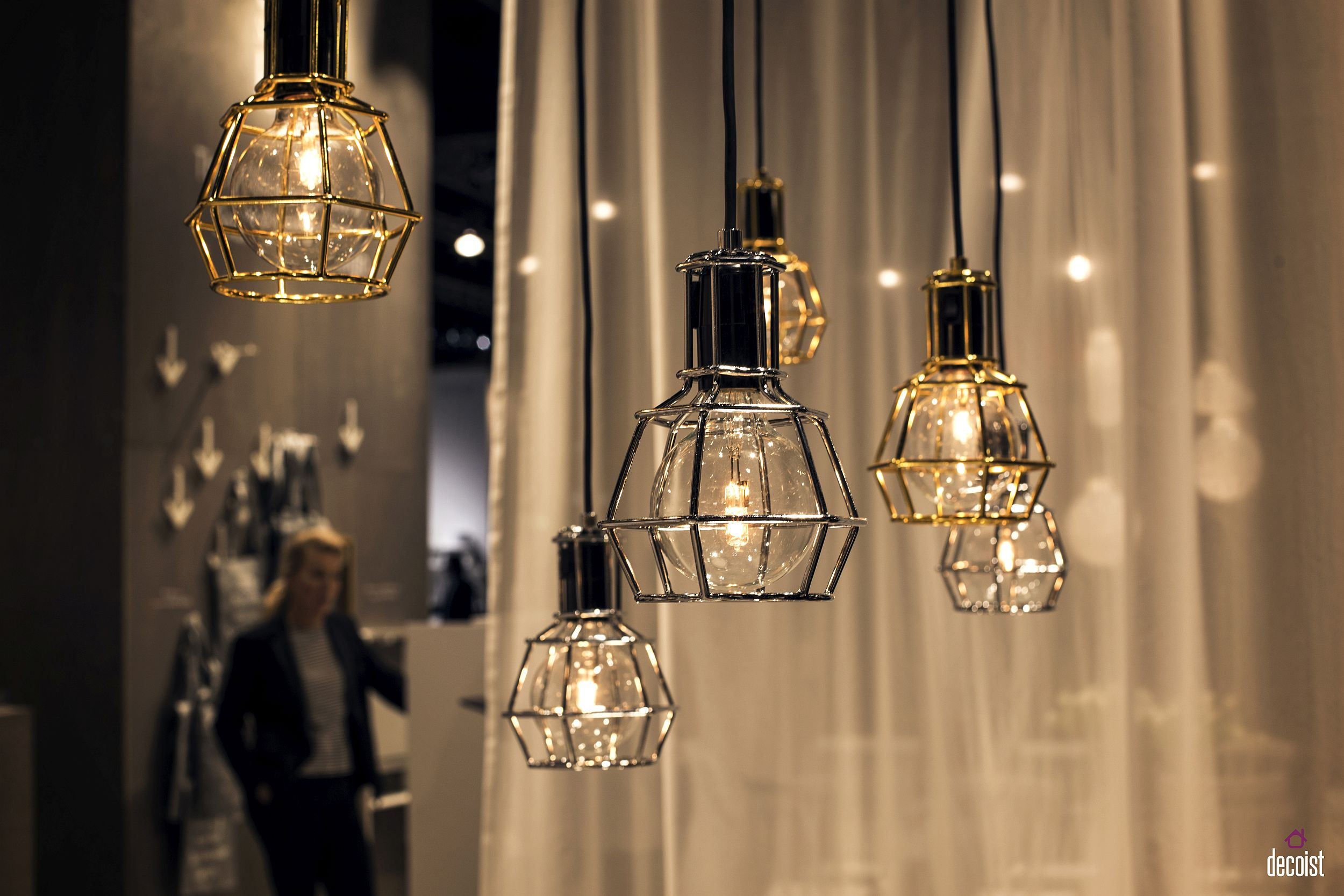 Wiry frame of the pendants gives them a cool, contemporary look with industrial vibe