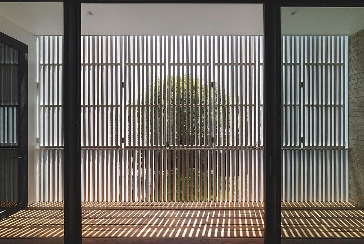 Wooden slats filter in sunlight to offer passive heating
