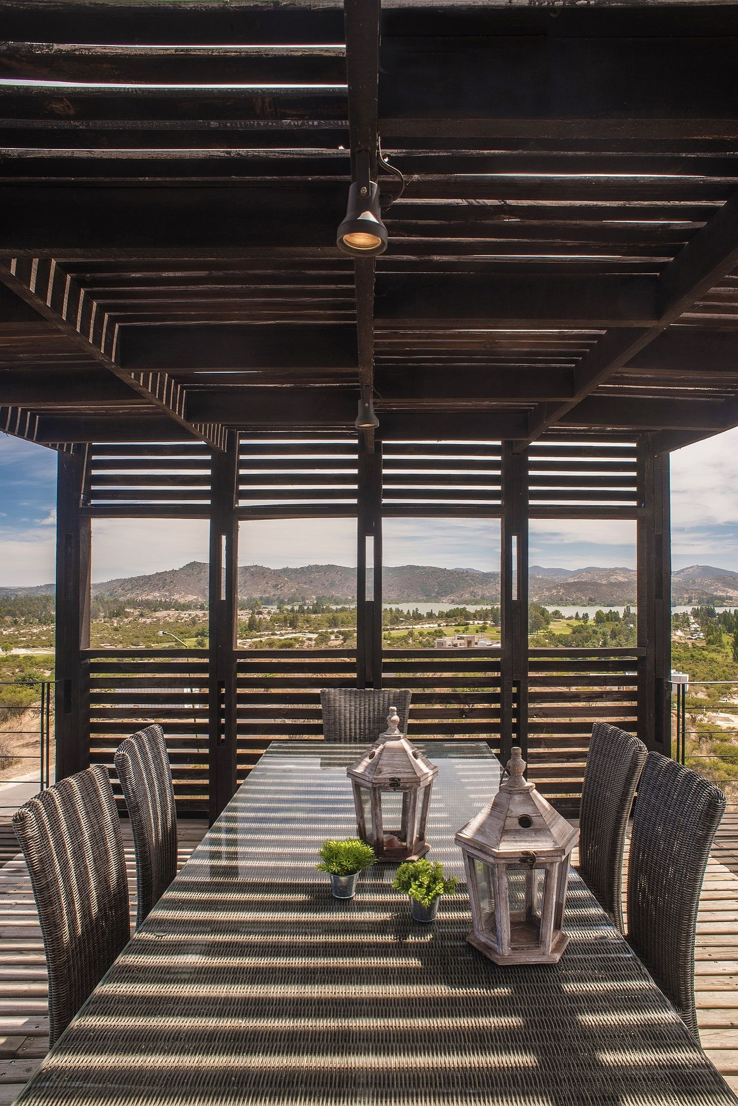 Wooden slats offer shade for the outdoor dining space