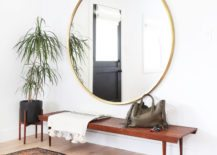 A-big-mirror-opens-up-the-entryway--217x155