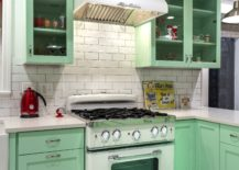 A-bold-mint-green-kitchen-in-combination-with-a-retro-stove-217x155