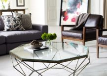 A-geometric-glass-coffee-table-adds-dynamic-and-transparency-to-the-room--217x155
