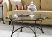 A-glass-coffee-table-with-metal-legs-is-a-daring-piece-that-feels-both-elegant-and-industrial-217x155