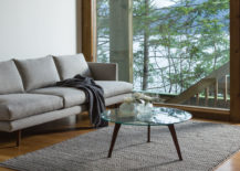 A-glass-table-helps-light-up-the-room-in-a-natural-and-beautiful-way-217x155