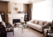A-living-room-with-a-dark-interior-needs-a-glass-coffee-table-217x155