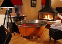 A-round-copper-bathtub-in-a-cozy-living-room--217x155
