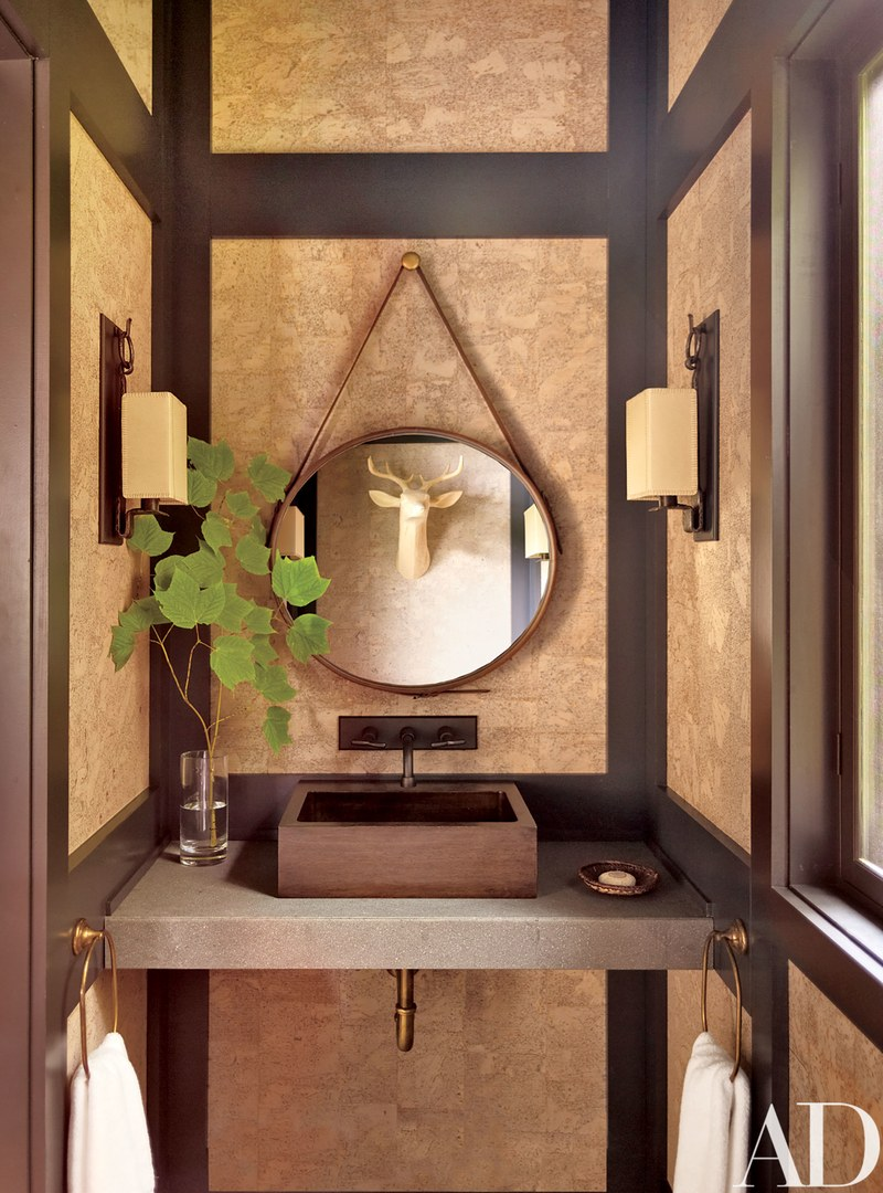 A wooden vessel sink in a country-styled bathroom