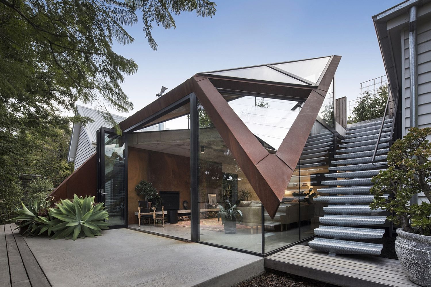Abstract glass and metal structure connects two existing buildings