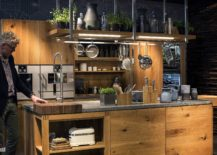 Accent-lighting-reaches-a-new-level-with-delightful-LED-strip-lights-in-this-classy-kitchen-filled-with-wood-217x155