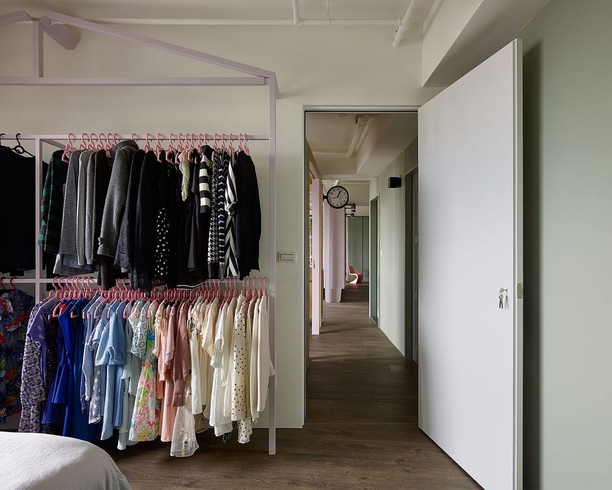 Ample space for clothes with standalone shelves in the bedroom