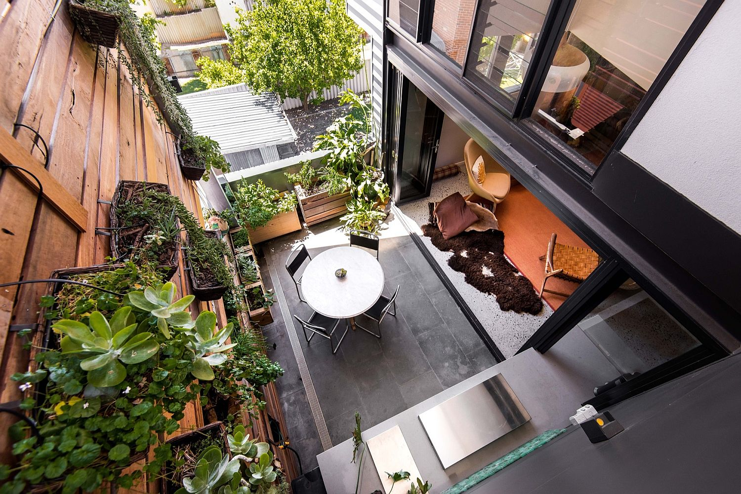 Balcony with smart living wall connected with the living area