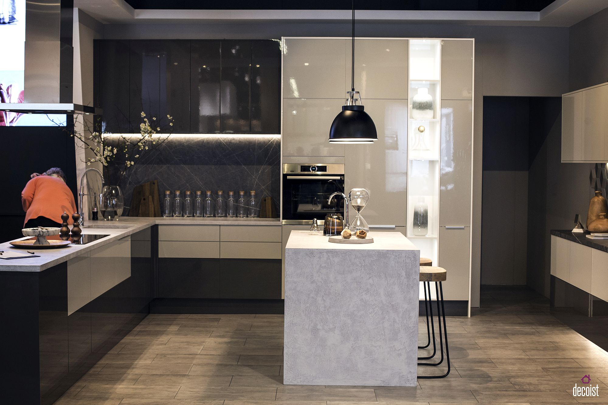 Beautiful and minimal island in white stands in contrast with the rest of the kitchen
