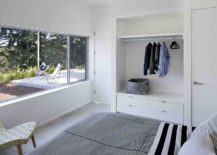 Bedroom-in-white-is-tucked-away-at-the-rear-of-the-guesthouse-to-offer-privacy-217x155