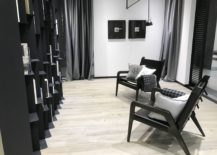Black-and-white-lounge-area-with-bright-wood-inspired-floor-tiles-by-Porcelanosa-217x155