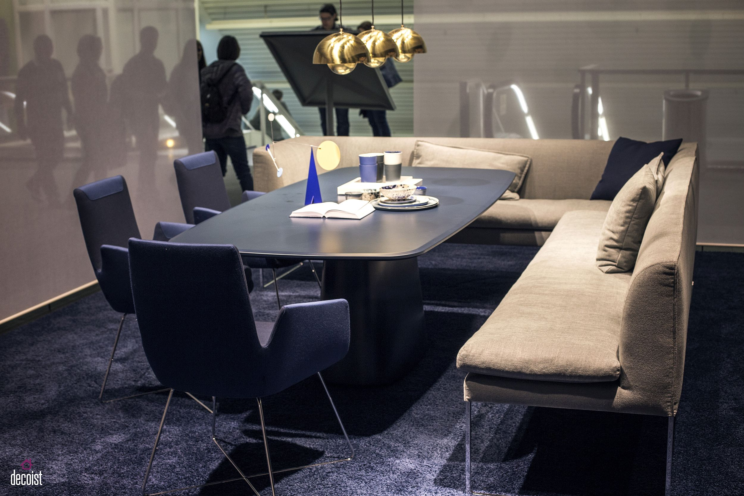 with blue chairs and a dashing table in the contemporary dining room