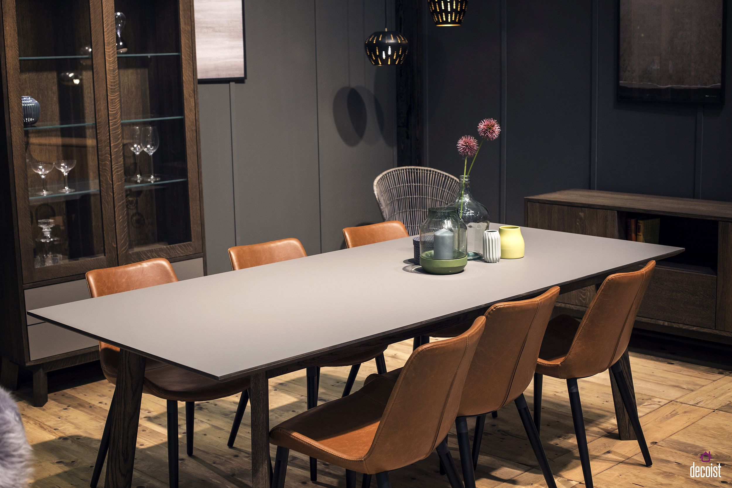 Brown leather chairs and a gray backdrop give the dining room a sophisticated, masculine look