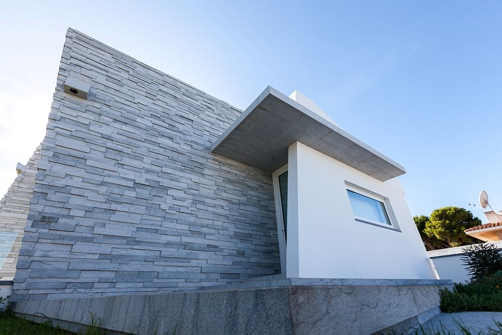 Brush hammered Grigio Ducale marble shapes the exterior of the Italian villa Cultured Minimalism: Margraf Marbles Define Polished Sicilian Villa
