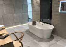 Cement-like-wall-and-floor-tiles-in-modern-bathroom-design-by-Porcelanosa-217x155