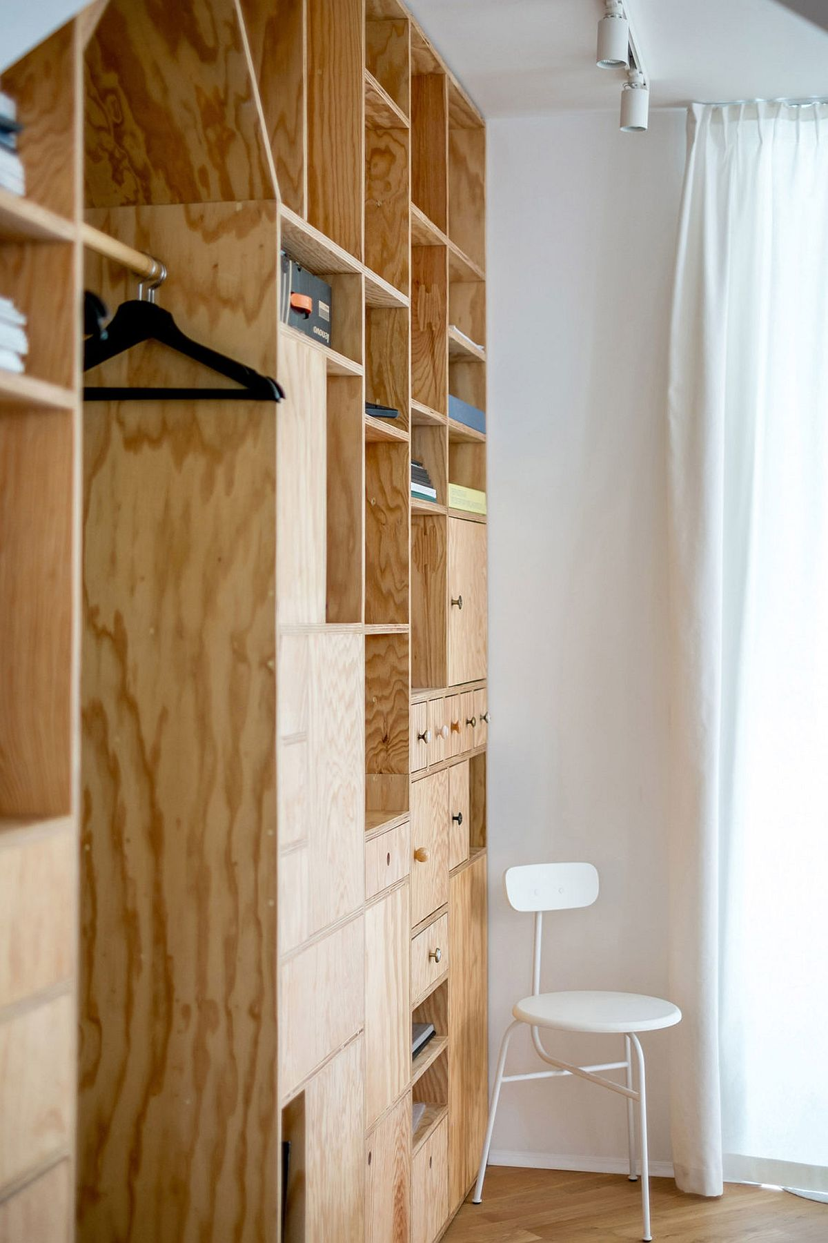 Closer look at the series of cupboards and shelves that make up the wooden partitions