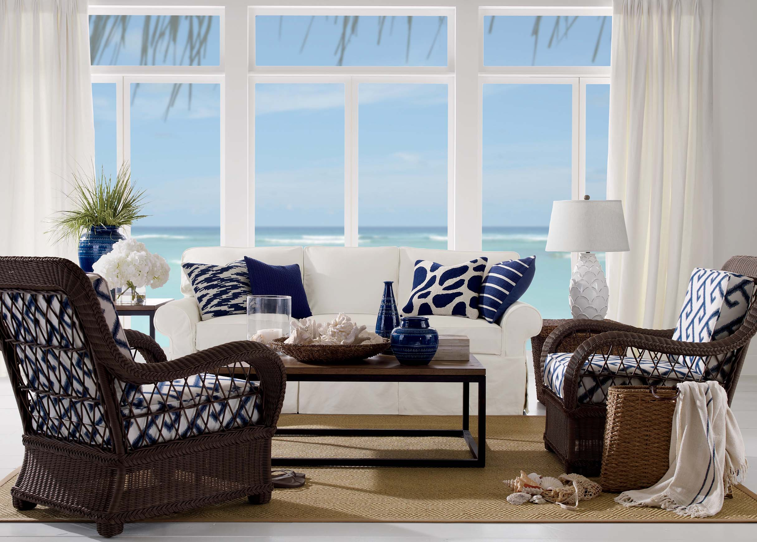 Dark woven chairs and navy blue cushions are the ideal contrast for a ...