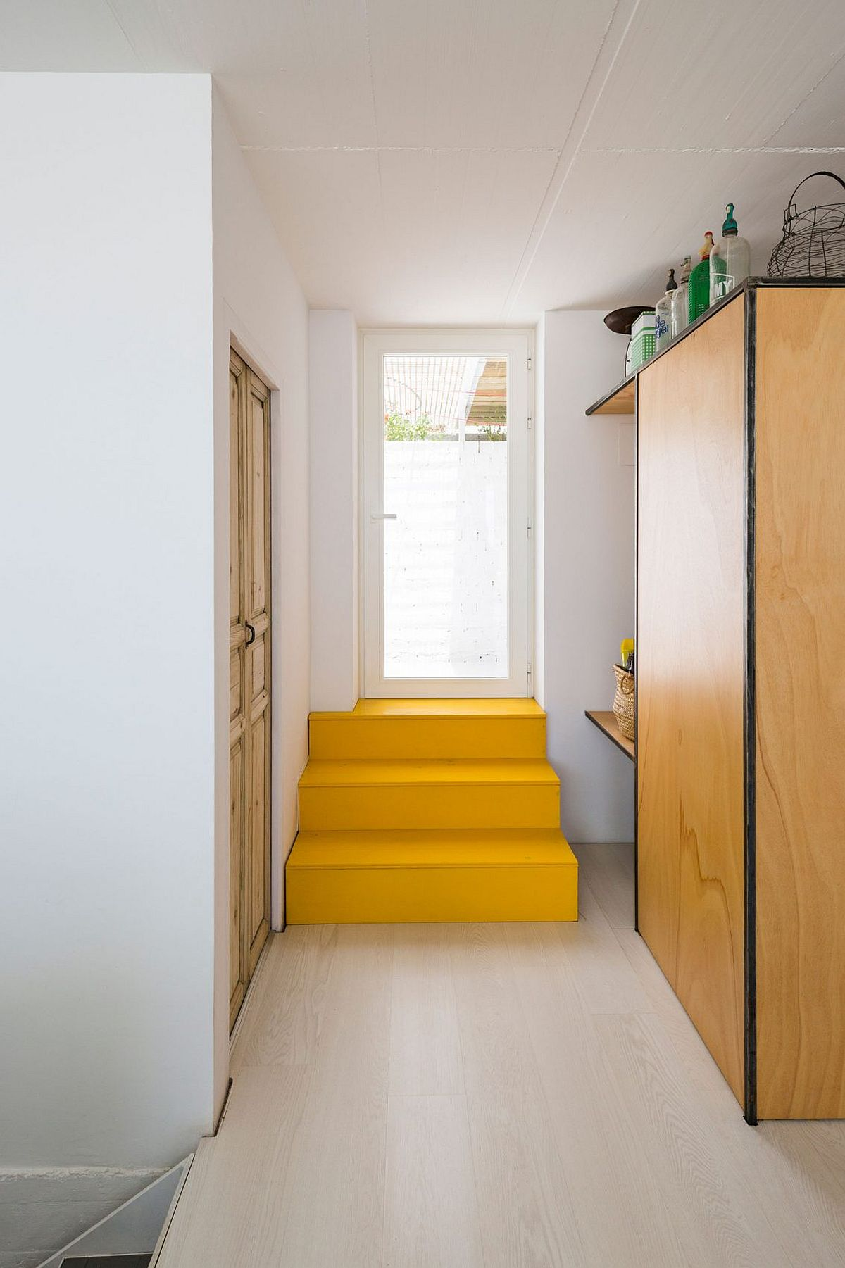 Colorful staircase in yellow inside the Spanish house