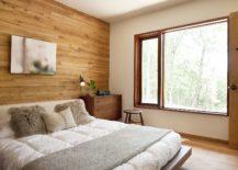 Comfy-bedroom-with-headboard-wall-in-wood-217x155