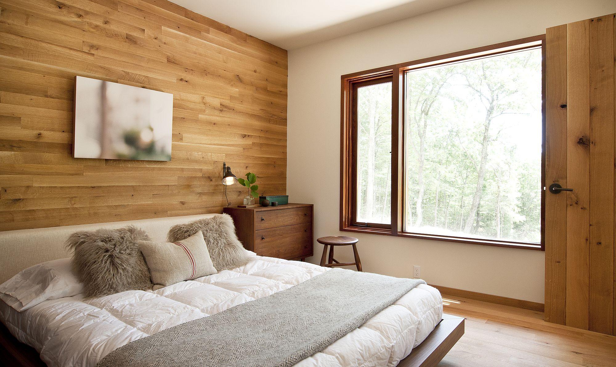 Comfy-bedroom-with-headboard-wall-in-wood