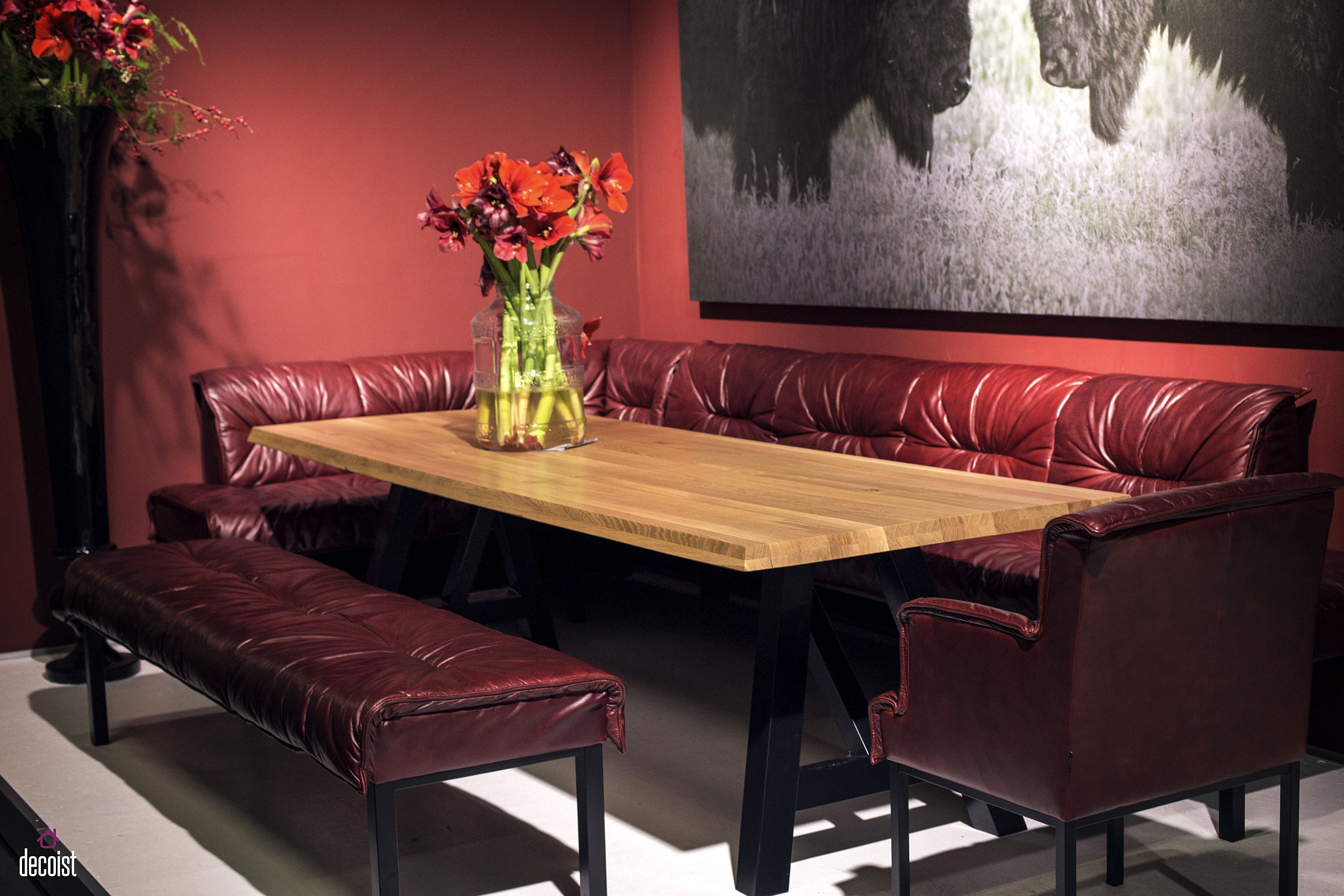 Comfy red banquette style seating along with a bold backdrop creates a stunning dining area