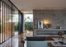 Concrete-and-wood-shape-the-living-room-of-Bravos-House-217x155