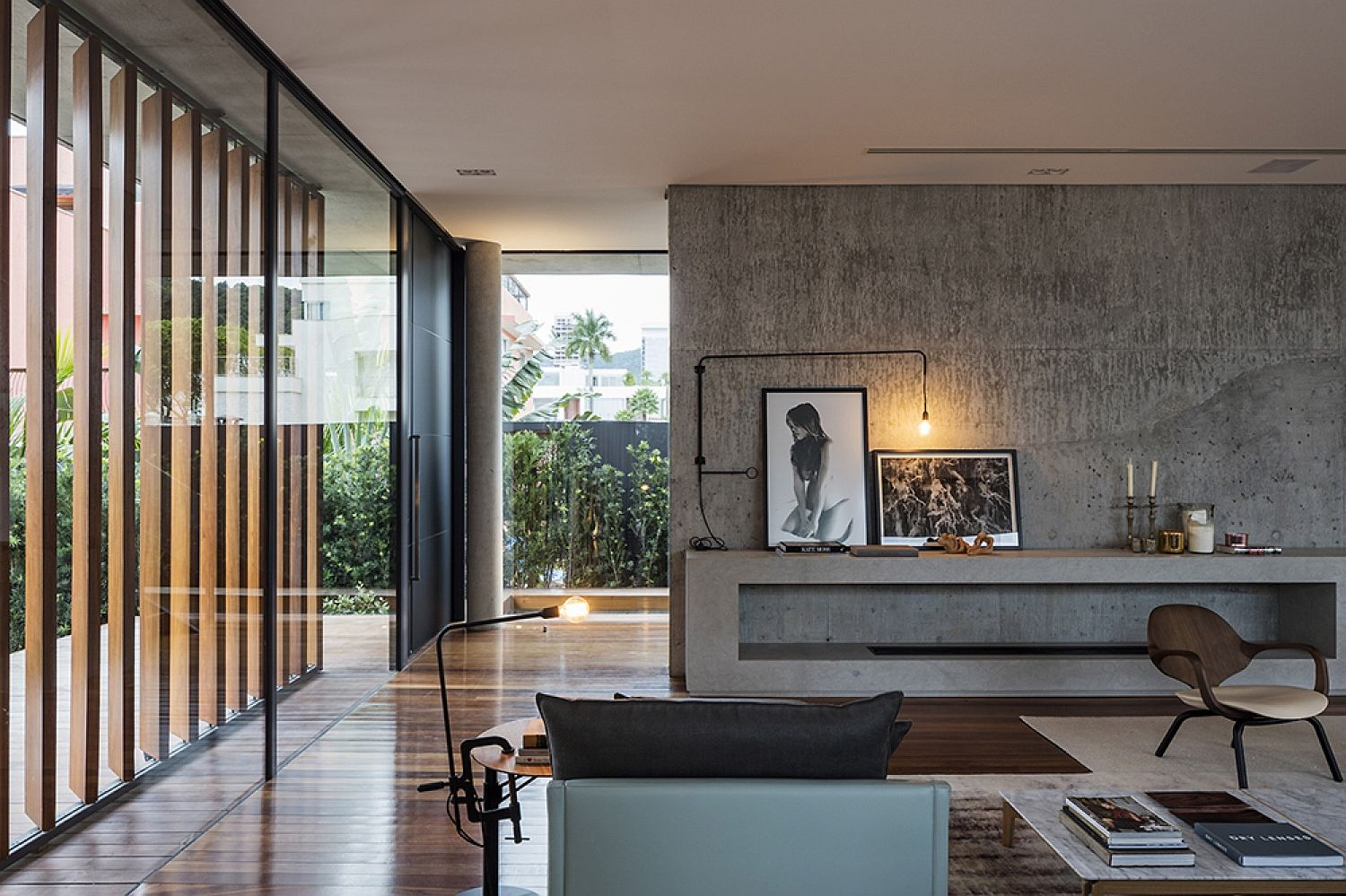 Concrete-and-wood-shape-the-living-room-of-Bravos-House