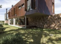 Concrete-cantilevers-wood-and-natural-stone-create-a-goregous-contemporary-home-217x155
